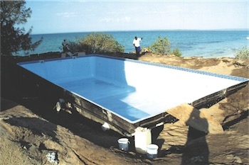 Fibre-mosaic is applied and the pool recoated with fibreglass.